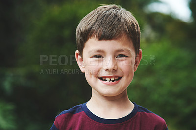 Buy stock photo Portrait of an adorable little boy standing in his backyard