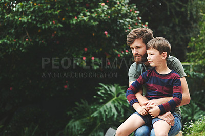 Buy stock photo Shot of an adorable little boy and his father spending quality time together in their backyard