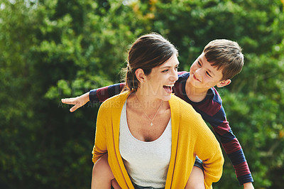 Buy stock photo Shot of an adorable little boy and his mother spending quality time together in their backyard