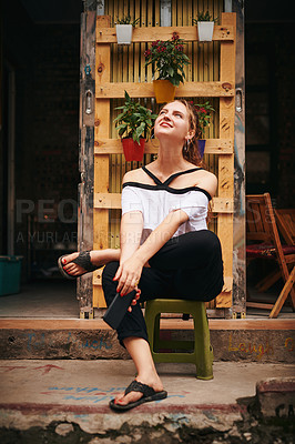 Buy stock photo Shot of a young woman exploring a foreign city