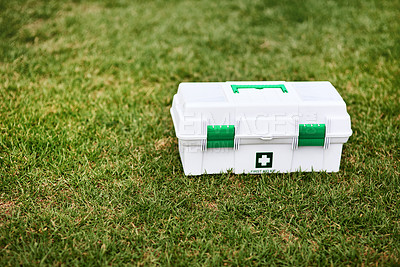 Buy stock photo Shot of a first aid kit on a rugby field