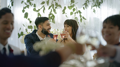 Buy stock photo Shot of a happy young couple toasting with wine at their wedding reception