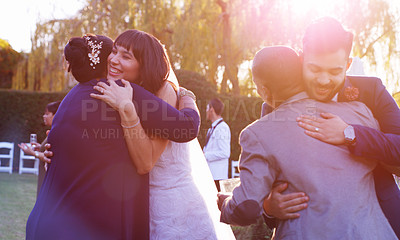 Buy stock photo Shot of a happy young couple embracing their guests after getting married