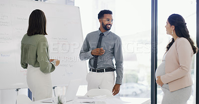 Buy stock photo Shot of three businesspeople having a discussion in the boardroom