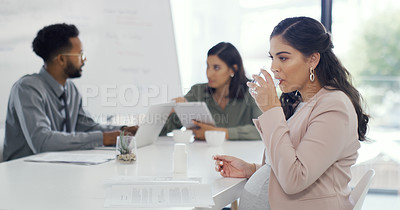 Buy stock photo Shot of a pregnant woman sitting in the boardroom with her colleagues