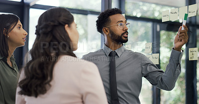 Buy stock photo Shot of three businesspeople having a brainstorming session in an office