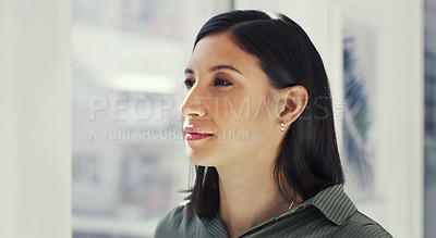 Buy stock photo Cropped shot of a young businesswoman looking thoughtful while standing in her office