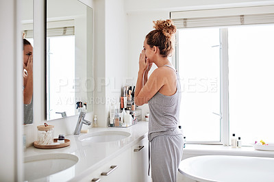 Buy stock photo Shot of a young woman smelling her breath during her morning grooming routine at home