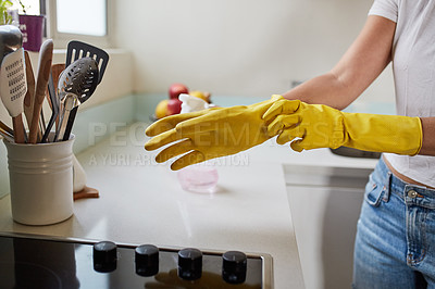 Buy stock photo Cropped shot of a woman cleaning the kitchen at home