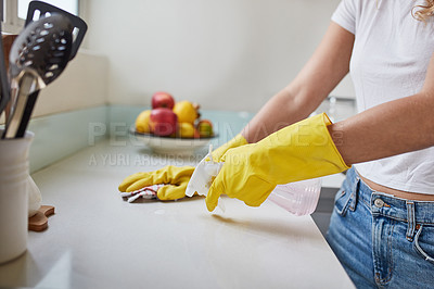 Buy stock photo Cropped shot of a woman cleaning a kitchen counter at home