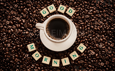 Buy stock photo Closeup shot of a cup of coffee surrounded by block letters forming the words