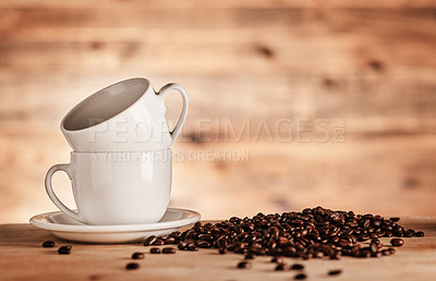 Buy stock photo Closeup shot of two cups surrounded by coffee beans