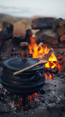 Buy stock photo Shot of a traditional South African food being cooked by campfire outdoors