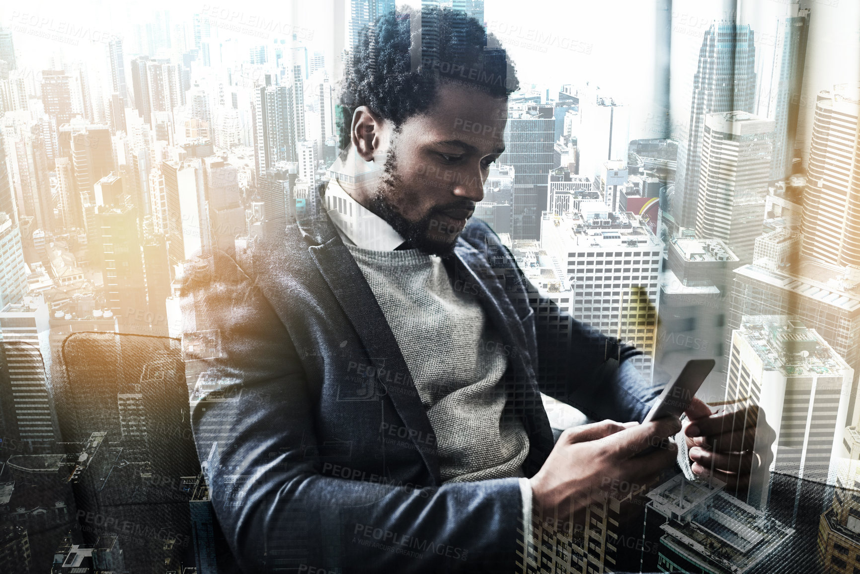 Buy stock photo Shot of a young businessman using a smartphone superimposed on a city background