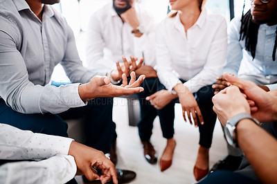 Buy stock photo Closeup shot of a group of unrecognisable businesspeople having a discussion in an office