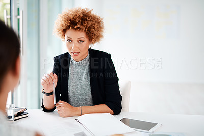 Buy stock photo Shot of a young businesswoman having a discussion with a woman in an office
