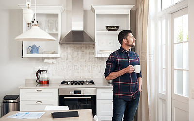 Buy stock photo Shot of a young man having a relaxing coffee break at home
