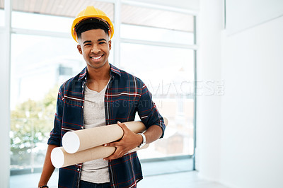 Buy stock photo Portrait of a young man and woman holding a blueprint in a modern office