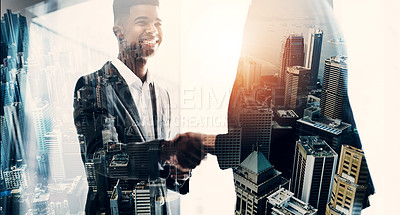Buy stock photo Superimposed shot of two businesspeople shaking hands in an office