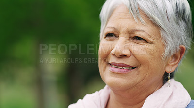 Buy stock photo Shot of a senior woman spending a day in the park