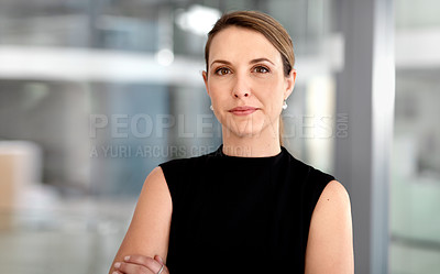Buy stock photo Portrait of a confident young businesswoman working in a modern office