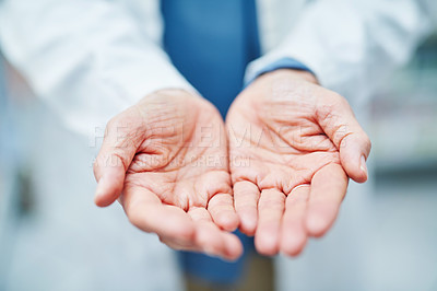 Buy stock photo Cropped shot of a pharmacist standing with her hands opened