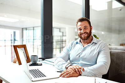 Buy stock photo Portrait of a young businessman sitting at a desk in an office