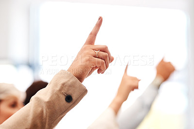 Buy stock photo Closeup shot of a group of unrecognisable businesspeople raising their hands