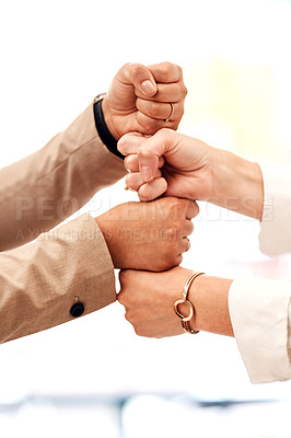 Buy stock photo Closeup shot of two unrecognisable businesspeople stacking their fists on top of each other
