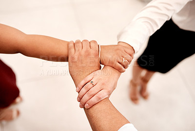 Buy stock photo Closeup shot of a group of unrecognisable businesspeople holding on to each other's arms