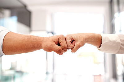 Buy stock photo Closeup shot of two unrecognisable businesspeople giving each other a fist bump