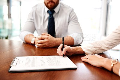 Buy stock photo Closeup shot of two businesspeople going through paperwork together in an office
