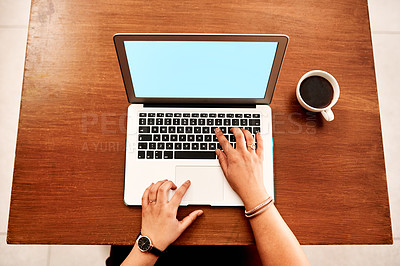 Buy stock photo High angle shot of an unrecognisable businesswoman using a laptop in an office