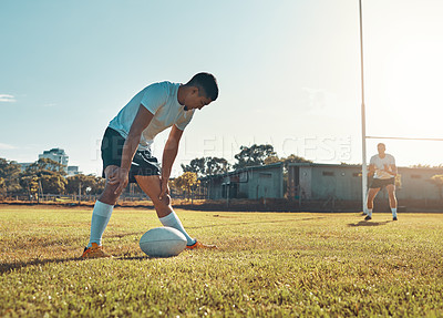 Buy stock photo Shot of a rugby player getting ready to score
