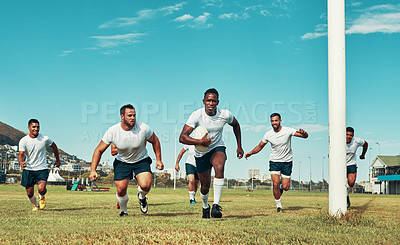 Buy stock photo Shot of a group of rugby players on a field