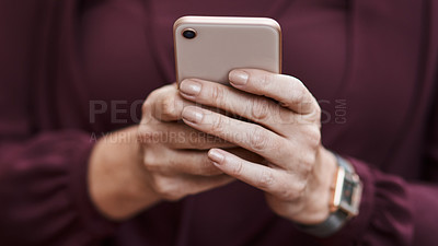 Buy stock photo Cropped shot of an unrecognisable businesswoman using a smartphone