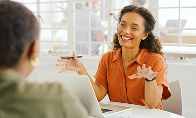 Buy stock photo Shot of two young businesswomen having a meeting in a modern office