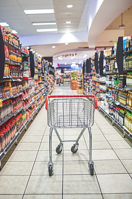 Buy stock photo Shot of an empty shopping cart in a grocery store