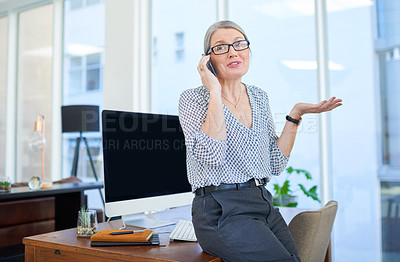 Buy stock photo Shot of a mature businesswoman talking on a cellphone in an office
