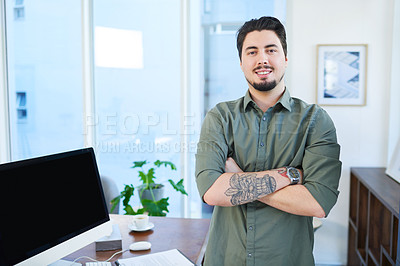 Buy stock photo Portrait of a young man standing with his arms crossed in an office