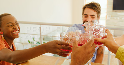 Buy stock photo Shot of a group of young friends toasting with drinks during a lunch party at home