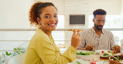 Buy stock photo Portrait of a young woman enjoying a lunch party with friends at home