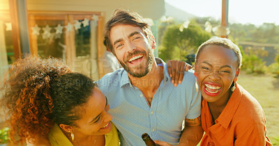 Buy stock photo Shot of a group of young friends having drinks together in a garden at home