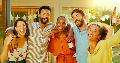 Buy stock photo Portrait of a group of young friends having drinks together in a garden at home
