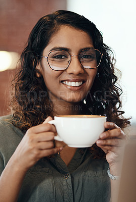 Buy stock photo Portrait of a young woman having coffee in a cafe