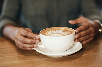 Buy stock photo Cropped shot of a woman having coffee in a cafe