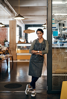 Buy stock photo Portrait of a confident young woman standing at the entrance of her cafe