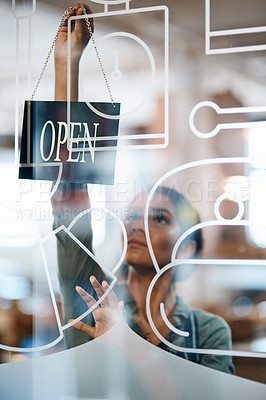 Buy stock photo Shot of a young woman hanging up an open sign on the door of a cafe
