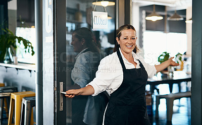 Buy stock photo Shot of a mature woman opening the door to her cafe