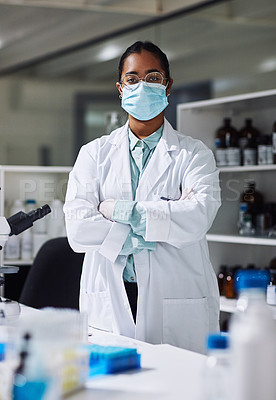 Buy stock photo Cropped portrait of an attractive young female scientist standing with her arms folded in the laboratory
